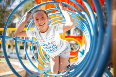 T-Shirt Mockup of a Happy Girl at the Playground a20959