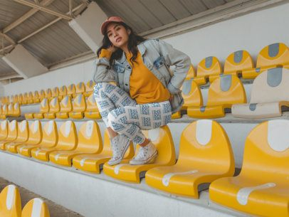 Mockup of a Girl Wearing Leggings and a Denim Jacket while in the Grandstand a19046