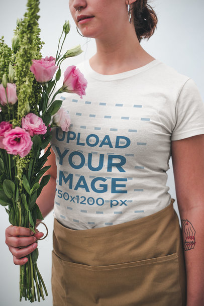 Closeup Mockup of a Woman Wearing a T-Shirt while Holding a Bouquet of Flowers a20501