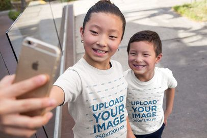 T-Shirt Mockup Featuring Happy Asian Kids Taking a Selfie on the Street 20965a