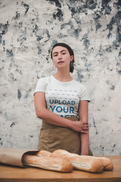 Mockup of a Baker Wearing a T-Shirt and a Waist Apron a20494