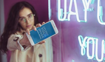 Rose Gold iPhone 7 Plus Mockup Being Held by a Woman with Glasses a21295