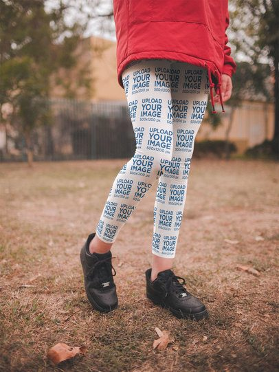 Close-Up Leggings Mockup of a Girl with a Red Coat at a Park a19198