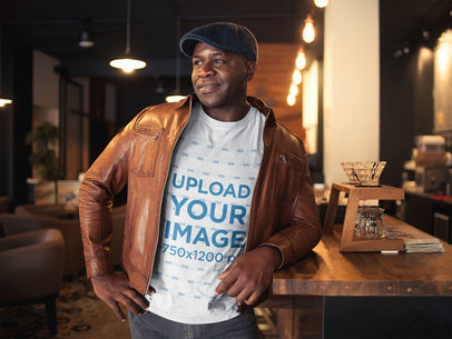Mockup of a Black Man Wearing a T-Shirt with a Brown Leather Jacket and a Beret a21418