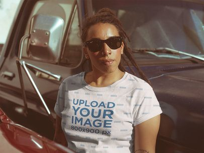 Mockup of a Black Woman Wearing a Sublimated T-Shirt Leaning Against a Truck a19927