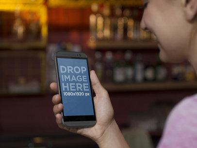 Mockup Generator of Woman Using Android Phone At The Bar