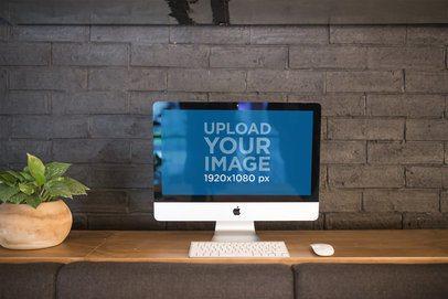 iMac Mockup Standing Against a Bricks Wall a21174