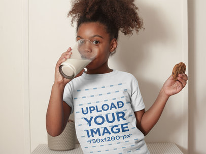 Mockup of a Black Girl with Curly Hair Drinking Milk Holding a Cookie a21326