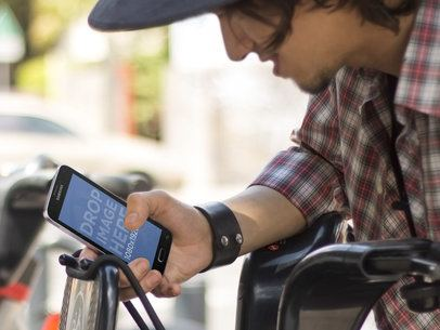 Guy Using Public Bike With Android Mockup Template