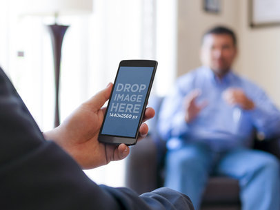 Android Mockup Template of Man at a Meeting