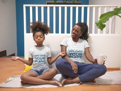 T-Shirt Mockup of a Kid in Lotus Position with her Mom at Home a21324