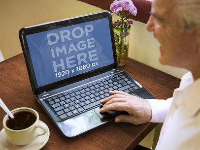 Elderly Gentleman Using HP Laptop While Enjoying Coffee