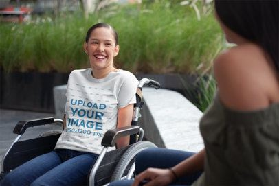 T-Shirt Mockup of a Happy Woman Sitting on a Wheelchair a21357
