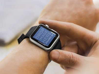 Mockup Template of Young Man Wearing Black Apple Watch on Left Hand