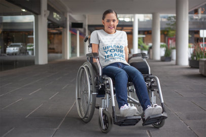 Mockup of a Woman Using a Wheelchair Wearing a T-Shirt a21359