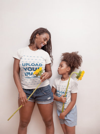 T-Shirt Mockup of a Black Girl with Curly Hair Holding a Sunflower with her Mom a21330