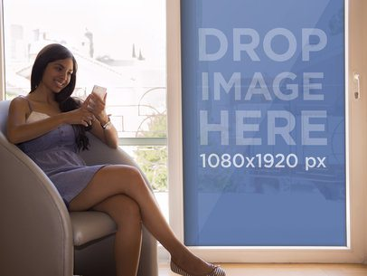 iPhone Mockup of Young Woman Sitting by the Window