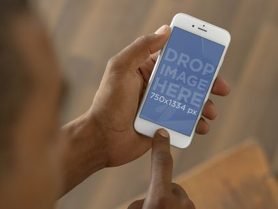 Close-up Shot of Man Using a White iPhone 6 Mockup