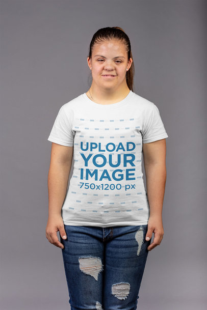 T-Shirt Mockup of a Girl with a Ponytail Standing in a Gray Room a21389