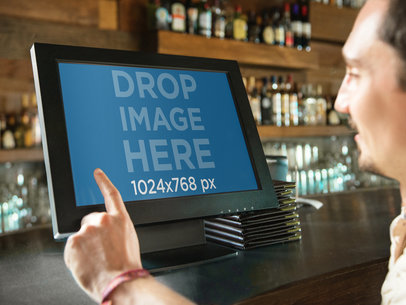 Desktop Mockup Featuring a Bartender Entering an Order at the Bar