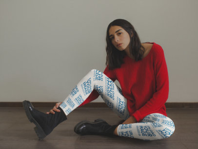 Mockup of a Girl Wearing Leggings and a Red Sweater Sitting on the Floor a19145