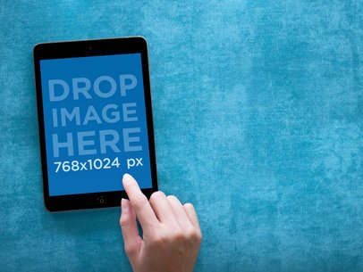 Tablet Mockup Featuring a Black iPad Mini on Vibrant Blue Backdrop 1111
