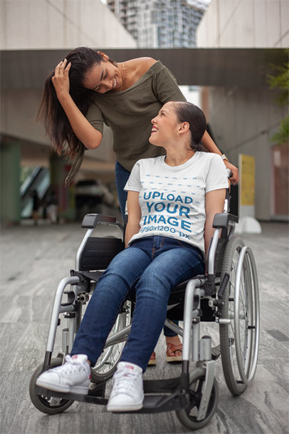 Mockup of a Girl Using a Wheelchair while Wearing a Tshirt with her Friend a21366