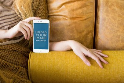 Mockup of a Silver iPhone 8 Plus with a Blonde Girl on a Sofa a21499