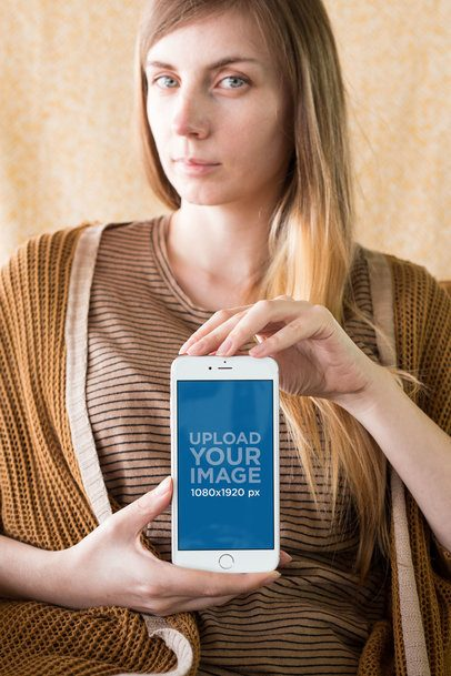 Silver iPhone 8 Plus Mockup with a Blonde Woman Dressed in Brown a21498