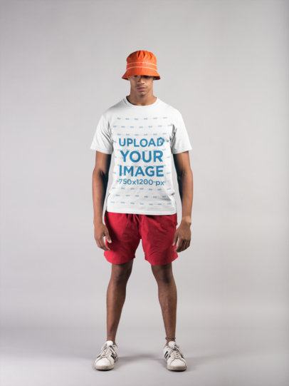 T-Shirt Mockup Featuring a Black Man Wearing Beach Clothing in a Photo Studio a21070