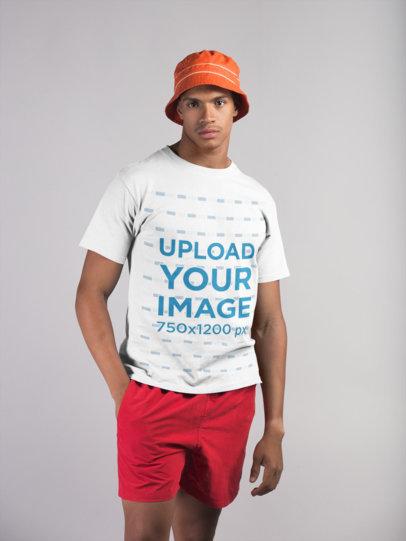 T-Shirt Mockup of a Man Wearing Beach Clothing 21072