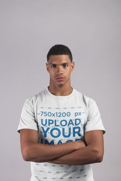 Front Shot Mockup of a Black Man Wearing a T-Shirt Against a White Background 21075