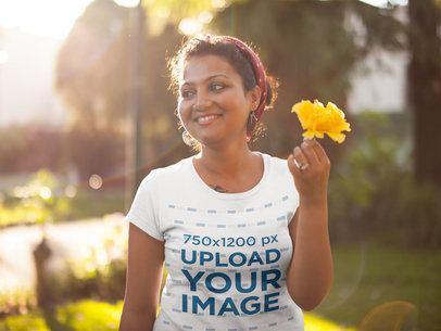 T-Shirt Mockup of a Beautiful Woman Holding a Yellow Flower 20653