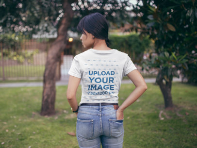 Back Shot of a T-Shirt Mockup Featuring a Woman at a Park 20574