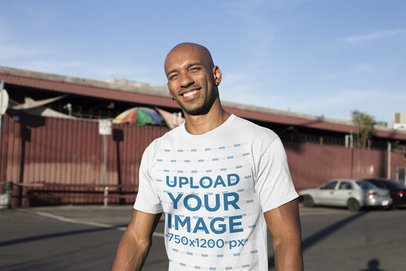 Mockup of a Smiling Man Wearing a Tshirt at a Parking Lot 18241