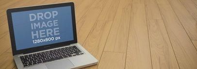 Mockup Template of a Macbook Pro Over Wooden Deck Floor