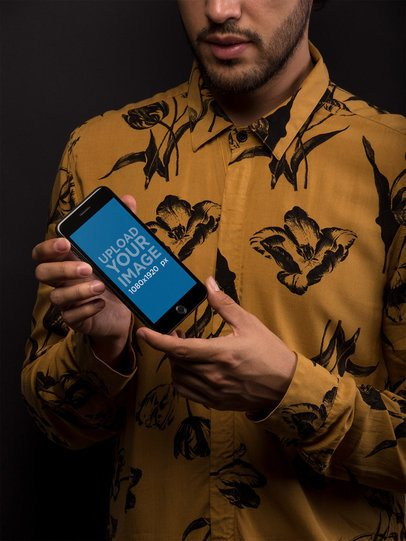 Space Gray iPhone Mockup Featuring a Man with a Flowers Printed Shirt 21747