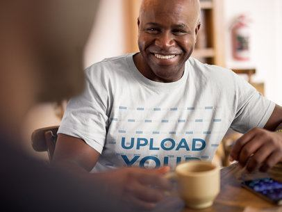 T-Shirt Mockup Featuring a Man Smiling 21469