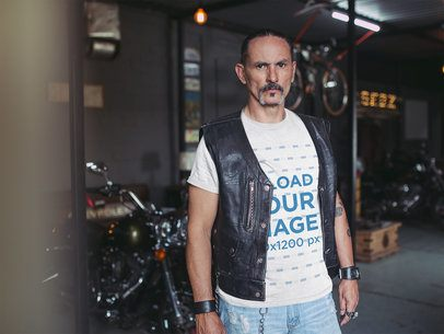 Mockup of a Tattooed Man Wearing a T-Shirt and Black Leather Vest 20248