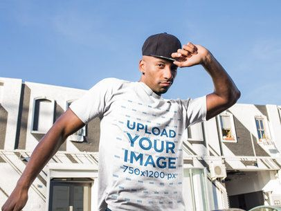 Mockup of a Man Wearing a T-Shirt and a Snapback Hat 18319