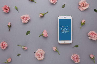 iPhone Mockup Lying with Pink Roses Heads and Leaves 21755