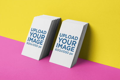 Business Card Mockup of Two Vertically Stacked Sets Leaning Against a Wall 21954