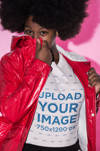 Mid Shot Tee Mockup Featuring a Woman with Afro Hair Hiding Her Face with a Rain Jacket 21709
