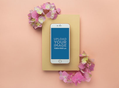 iPhone 8 Plus Mockup on a Yellow Cardboard with Pink Flowers 21989
