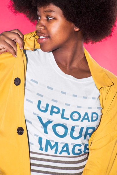 T-Shirt Mockup Featuring a Woman In Front of a Hot Pink Background 21718
