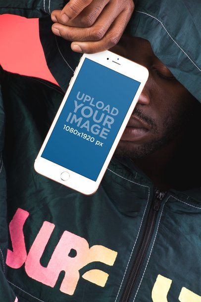 Mockup Featuring a Man in a Black Urban Zip Hoodie Showing a Gold iPhone 8 22125