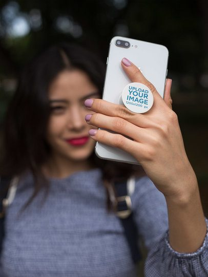 Phone Grip Mockup Featuring a Smiling Girl Taking a Selfie 22064