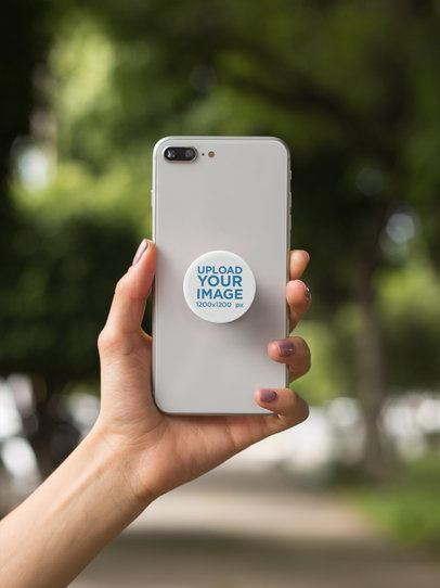 Phone Grip Mockup Held by a Woman's Arm 22065