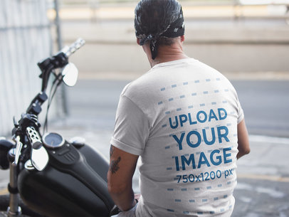 Backshot T-Shirt Mockup of a Biker Man Wearing a Bandana 20243