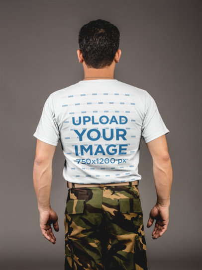 Backshot Tshirt Mockup of a Middle-Aged Soldier Standing Against a Gray Wall 21257